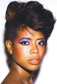 african american woman fx makeup | kelis with rainbow eye make up in purple pink and yellow combined with ...