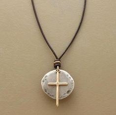 """An oxidized sterling disc provides the backdrop to a slender 10kt gold diamond-set cross. Leather cord adjusts to vary the length. Made in USA by Rebecca Lankford. Approx. 45""""L."""