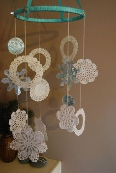 doily mobile :) use w/ lamp shade skeletons