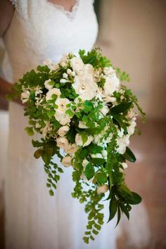 STUNNING Cascading Bridal Bouquet: White Roses, Ranunculus, Delphinium, Green Maiden Hair Fern, & Several Other Varieties Of Green Foliage