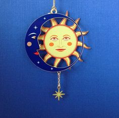 Blue Moon and Sun Ornament in radiant color on brass and hand screen printed makes each one unique. The contrasting colors are quite nice.