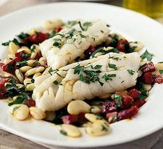 There's no need for cooking fish to be a chore - this dish will be before you in 10 minutes  ~ I want to try this recipe, but using white/cannelini beans vs. butter beans, & spinach vs. parsley, & smoked polish sausage vs. chorizo (a.k.a., Mexican Mystery Meat, LOL!).