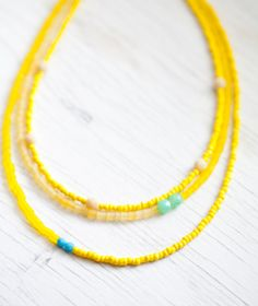 Bright Yellow Glass bead Necklace . Cream faceted glass beads accents . Summer. $18.00, via Etsy.