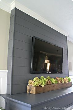 $13 planked fireplace wall using underlayment board & corner molding