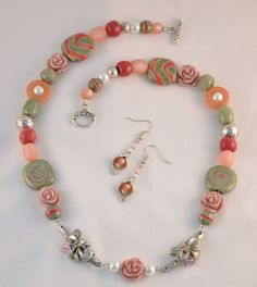 Entry by Anja Schiller.  Anja used the Dorabeth Branch with Blossom and Calla beads for the earrings making this charming necklace and earring set.