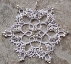 Pearly I didn't want to make plain snowflakes, but I wanted a pure look to them. I think the pearls did the trick. The pattern c...