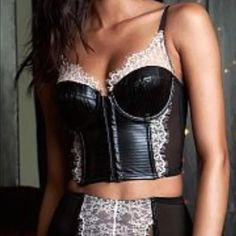 Victoria's Secret Faux Leather Bustier 32C Victoria's Secret bustier!  Features faux leather and lace! Slightly lined and underwire.  Adjustable straps.  Front clasp closure. Victoria's Secret Intimates & Sleepwear Bandeaus