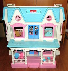 Fisher Price Loving Family Dollhouse 1990 I think I had a friend with this dollhouse or it was at school or daycare