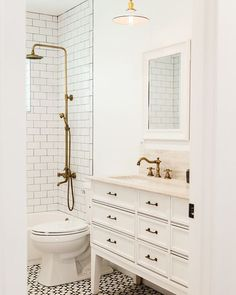 Here's a little hall bathroom fun from a home we completed late last year. Photo by @aceandwhim