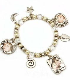 Silvertone Bead Picture Frame Charm Bracelet Add Your Own Photos Sabz Jewelry. $19.99. stretch bracelet acrylic beads. small charm photo holders for your pictures 20 mm wide. stretch bracelet add your own photos. will make a wonderful gift idea. nickel and lead free. Save 33%!