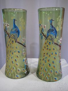 Period: 20th Century 		 				 			Description Antiquity 			 			Pair of enamelled glass vases