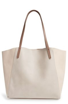 Free shipping and returns on BP. Colorblock Faux Leather Tote at Nordstrom.com. Color blocking in fresh hues details a roomy faux-leather tote topped with long, slender straps that slip comfortably over the shoulder.