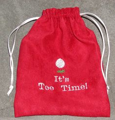 Embroidered, extra sturdy and extra large golf tee bag.  Handy for carrying wallet, keys, money and tees while Dad is on the links.  $10.00.  I'm happy to personalize them for an extra two bucks.