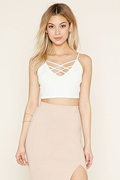 Shop a variety of styles in women's tops at Forever Find knit and woven blouses, cami's, tees, sweaters, short and long sleeve tops for women! Belly Shirts, Half Shirts, Sleeveless Crop Top, Cropped Sweater, Cropped Cami, Sweaters For Women, Two Piece Skirt Set, Crop Tops, Clothes For Women