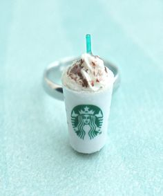 this ring features a miniature starbucks frappucino drink. it measures about 2.5 cm tall it is securely attached to an adjustable silver tone ring that fits most ring sizes.