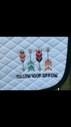 Arrow embroidery on a saddle pad
