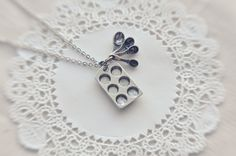 the little baker necklace in antiqued silver. I think someone may need to buy this for me for my bday. :)