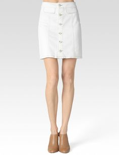 A nod to the 70s, our Bianca skirt is designed with a button down front, dual hip pockets and slight, A-Line shape. This season favorite also utilizes heritage, denim hardware and pieced construction with visible, front seamlines to create an ultra flattering fit. Our crisp, Blanc wash acts as a chameleon, effortlessly pairing with any look. Center Front Length: 16 1/2'; Sweep: 39'; 98% Cotton, 2% Elastane #Paige #Skirts #Blanc