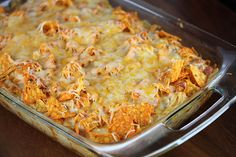 Chicken Dorito Casserole Ingredients: 2 cups shredded cooked chicken 2 cups shredded Mexican cheese blend (divided) 1 (10 oz) can cream of chicken soup ½ cup milk ½ cup sour cream 1 can Ro-tel tomatoes (drained) ½ packet taco seasoning 1 large bag Doritos