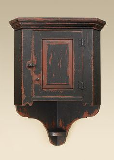 Hanging cabinets would look great in a country setting. We offer hanging shelves, cabinets and cupboards. They have rustic painted finishes.,Hanging cabinet with a primitive finish is the farmhouse hanging corner cupboard.