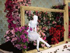 Picture frames adding depth and interest to floral display