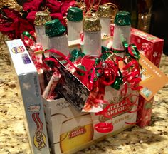 Man gift basket. 6 pack of beer, fast food gift cards (use any gift card) tied to each bottle, Peeps candy as the ends, stuffed with Smarites & Reece cups. Tape Reece cups upside down to tips of bottles. My boss is going I love this!! All his favorite things.