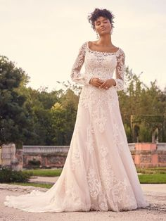 Featuring a floral-shaped train and irresistible motifs, this chic beaded lace bridal gown is refined enough for the ballroom yet perfectly boho for an enchanted fairy forest. Chic Wedding Dresses, Maggie Sottero Wedding Dresses, Wedding Dress Pictures, Blush Gown, Bridal Lace, Bridal Gown, Princess Ball Gowns, Bridal Looks, Bridal Collection