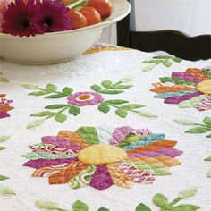 Miss Kyra: Bright Floral Dresden Plate Appliqué Wall Quilt Pattern Designed by ERIN RUSSEK Machine Quilted by KAREN DOVALA; this quilt is patterned in McCall's Quilting magazine, July/August 2013, available for purchase in print or instant digital download edition at www.QuiltandSewShop.com/category/mccalls-quilting/?m=categorysub_mccalls-quilting