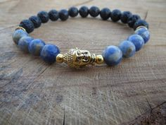 Check out this item in my Etsy shop https://www.etsy.com/listing/236262419/sodalite-antic-gold-tierracast-buddha