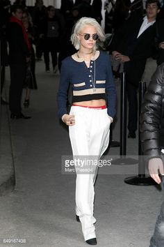 Model Cara Delevingne leaves the CHANEL show as part of the Paris Fashion Week Womenswear Fall/Winter 2017/2018 on March 7 2017 in Paris France