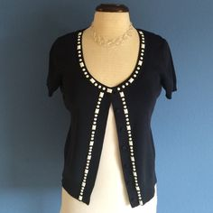 New ListingNavy/White Short Sleeve Cardigan Navy and white are always a beautiful combination.  This navy is so dark, you would almost think it was black.  The neckline and front are trimmed with white beads.   Material: 63% Rayon/37% Nylon LOFT Tops