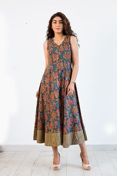 A long panel dress in a beautiful  paisley block print cotton Malmal fabric which is just right for any occasion.The beauty of the print design is in the use of over six color block and the finesse of execution of the print by the craftsman.  Wear it with wedge heel sandals & stone jewelry , it creates a classic elegant look for Resort wear or to meet up with friends !  One of our most popular style loved by all for it's feminine and comfortable cut !  100% cotton hand block print with Rapid…