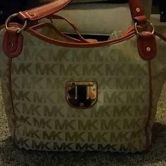New Michael kors bag Used twice, orange and tan, great condition Michael Kors Bags