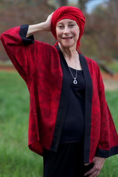 """AdvancedStyle says: """"Diana started wearing different scarves and head embellishments due to the  effects of a medical condition. Since recovering she continues to wear her turbans and wraps and has a renewed sense of freedom.""""  I love the red quilting-cotton coat over the simple dark dress. More like her at https://www.pinterest.com/yrauntruth/grow-up-age-croning/"""