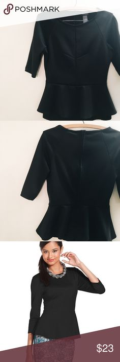 Bisou Bisou Black Peplum Top This top is a staple in your capsule wardrobe! The ¾ sleeves give you extra coverage on those cooler days or freezing conference rooms. The hint of spandex (8%) hugs curves in the right places and the peplum flatters your waist. With a zipper on back, this top is easy pull on and off. Bisou Bisou Tops