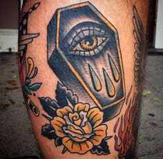 Traditional yellow and black coffin  rose tattoo by Steve Minerva