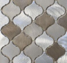 A balanced blend of warmth and coolness make this tile an easy choice for the home. These are a smaller arabesque tile than our glass tiles. Each tile is made from brushed aluminum. They are roughly 2 Kitchen Redo, Kitchen Backsplash, New Kitchen, Backsplash Ideas, Tile Ideas, Kitchen Remodel, Backsplash Panels, Mirror Backsplash, Kitchen White