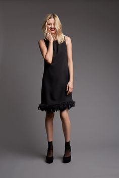 We just love this black dress with feather hem from Ril's.