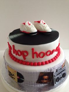 hip hop hooray! hip hop baby shower themed cake with Jordan 5 Fire Red fondant figures and edible vinyl album covers by Baked Keepsakes.