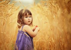 The soft focus around the face is gorgeous, not to mention the purple dress against the wheat.