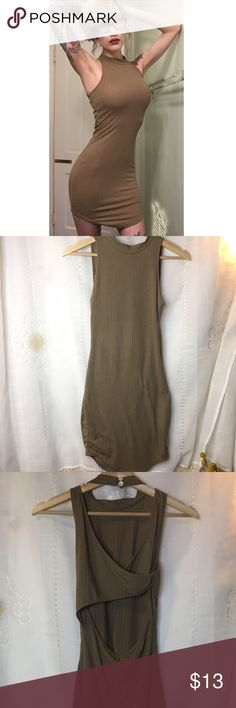 Ribbed bodycon dress Worn gently 1-2x thin stretchy ribbed tshirt sort of material, revealing but not see through (recommend nude seamless undergarments), mock neck, cross cut out back, asymmetrical hem. No signs of wear. This dress is simple but hot- I called it my naked dress💁🏼 super comfey and super flattering. Color is taupe/ light brown. Tag size small, fits xs-so Dresses Mini
