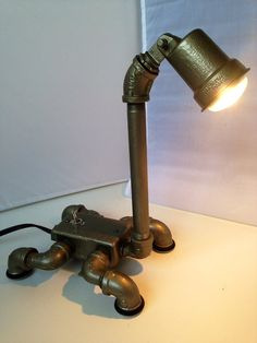 Dino an industrial dinosaur themed lamp by ICHomeDesigns on Etsy, $269.00