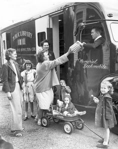 This photograph of a family standing in front of a bookmobile in Cincinnati was taken in 1948.
