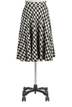 Our cotton check skirt in a full circle silhouette is styled with a wide banded high waist in front and elastic smocked at the center back waist. Trapunto stitching at the waist adds a light quilted feel for Fall.