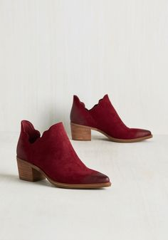 These bright burgundy ankle boots with pointed, distressed toes and stacked heels, will definitely your new obsession.