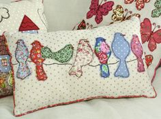 Hand sewn birds & butterflys - good way to use up those leftover scraps of fabric. Available to buy here http://www.dotcomgiftshop.com/patchwork-birds-cushion?ptid=%2C5467&ctid=5449&pos=3