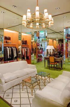 Closet - gilt mirrors, inset clothing (Tory burch store, charlotte)