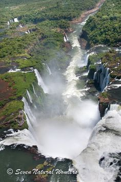 Iguazu Falls - brazil access the view over this ledge. Literally take a mile and a half walk over the river to the mouth of this 'devil's throat'. Water coming at you from below, amazing view looking straight down over the mouth of this waterfall. Add it to your someday list- this is a must do in your life!