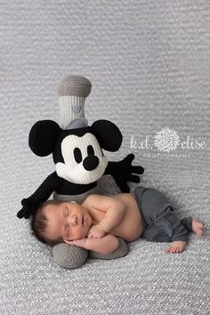 Newborn boy curled up on Steamboat Mickey. By Pueblo newborn photographer K.D. Elise Photography.