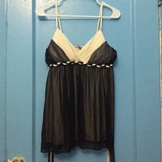 Dressy black and white top Nice new top with tie in the back and adjustable shoulder strap, can be worn without bra , 100% polyester Hot Kiss Tops Blouses